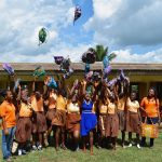 Girls show off their new menstrual kits provided by interns with Day for Girls in Ghana