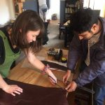 Intern Jenny S. works with an artisan at Pia Nepal in Kathmandu