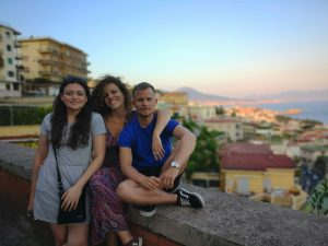 photo of three people with a mountain in the background